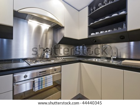 modern luxury domestic kitchen with granite worktop - stock photo
