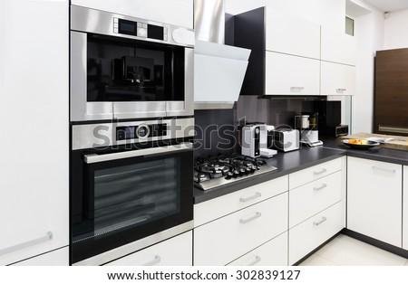 Modern luxury hi-tek black and white kitchen interior, clean design - stock photo