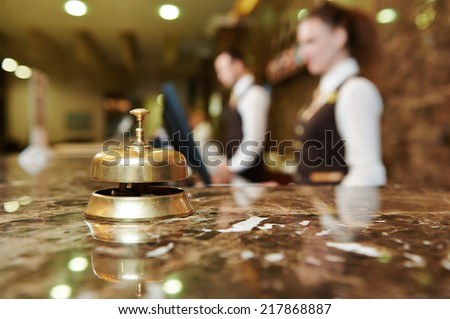 Modern luxury hotel reception counter desk with bell - stock photo