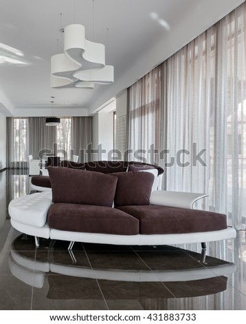 Modern luxury interior in minimalistic style: living room with sofa in daylight - stock photo