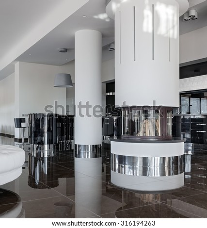 Modern luxury interior with round fireplace in minimalistic style - stock photo