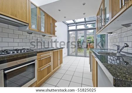 modern luxury kitchen unit with bright atrium - stock photo