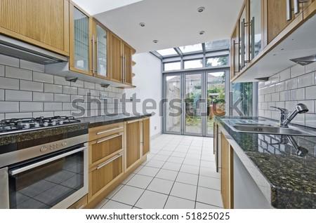 modern luxury kitchen unit with bright atrium - stock photo