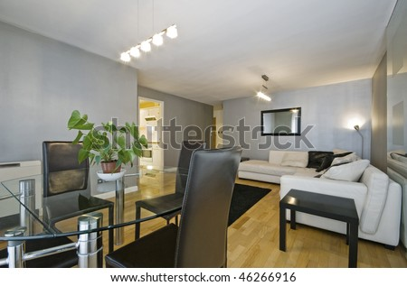 modern luxury living room with dining table and metallic wall paint - stock photo
