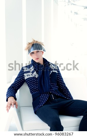 modern male model with futuristic sci-fi visor sitting in white indoor - stock photo