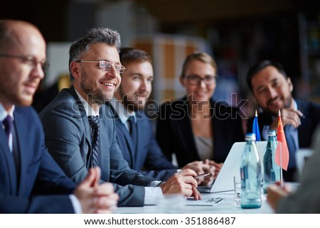 Modern managers listening to speaker at conference or seminar - stock photo