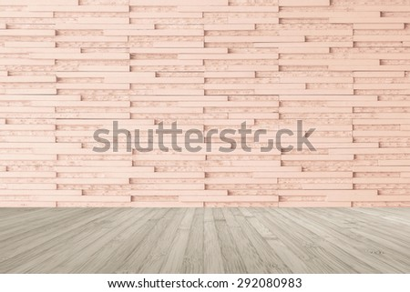 Modern marble tile wall pattern  background in light red brown color with wooden floor in sepia grey tone : Horizontal marble rock stone tiled pattern texture backdrop with wood flooring           - stock photo