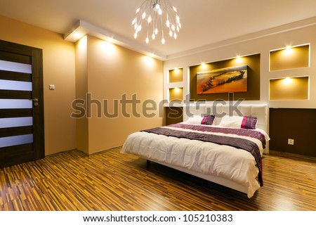 Modern master bedroom interior with picture of shipwreck on the wall (photo coming from my gallery) - stock photo
