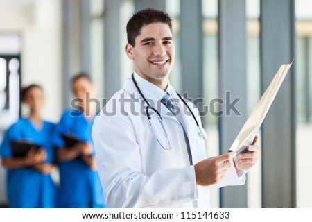 modern medical doctor holding patient's x-ray film - stock photo