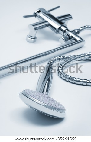 modern metal faucet and shower close up - stock photo