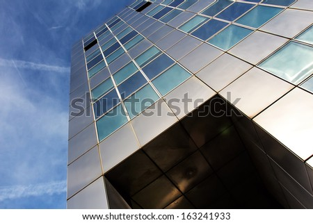 Modern metallic architecture against a blue sky - stock photo