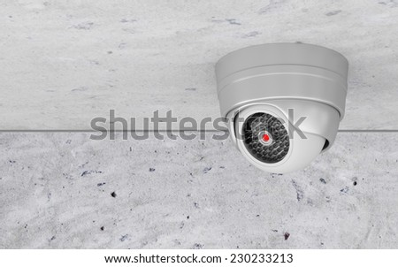 Modern Metallic Security Camera on the Ceiling - stock photo