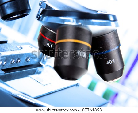 modern microscope in a lab - stock photo