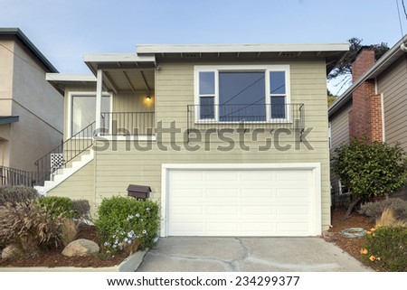 Modern Mid Century Hillside Home with blue sky. - stock photo