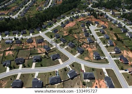 Modern middle class suburban neighborhood aerial. - stock photo