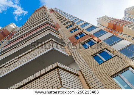 Modern multistory residential buildings in sunny day - stock photo