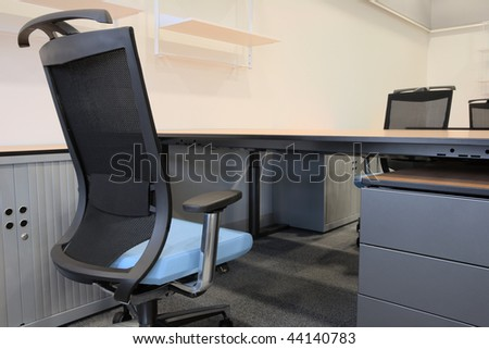 Modern new furniture in an empty office - stock photo