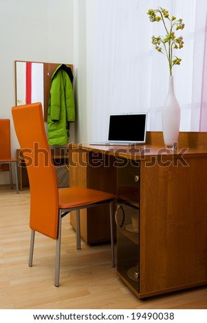 Modern notebook on a table in a beautiful apartment - stock photo