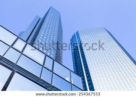 modern office building and clear blue sky - stock photo