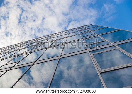 modern office building and sky with clouds reflection - stock photo