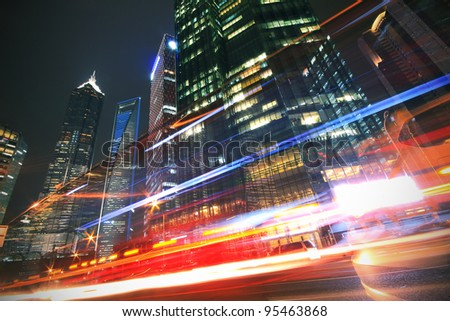 Modern office building background of night with light trails  in Shanghai - stock photo