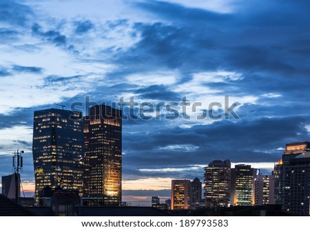 Modern office building captured at dusk in Jakarta central business district, Indonesia - stock photo