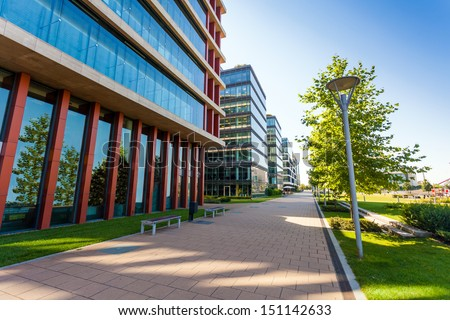 Modern office building detail with transparent glass wall - stock photo