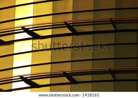 modern office building of glass gold - stock photo