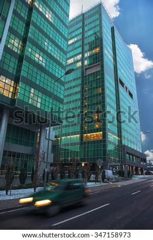 Modern office building. Street with traffic blurred - stock photo