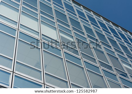 Modern office building under blue sky. - stock photo