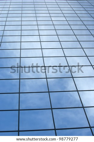 Modern office building with blue square windows. - stock photo