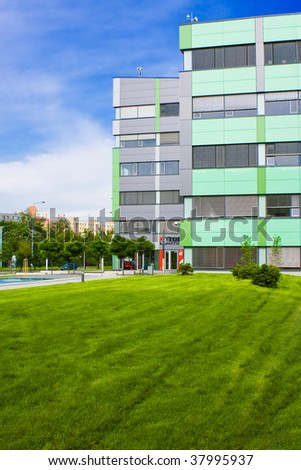 Modern office building with green lawn - stock photo