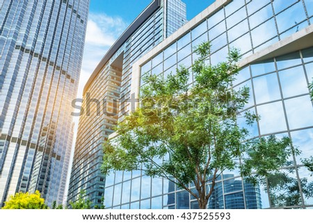 modern office building with green trees - stock photo