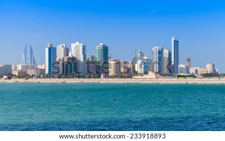 Modern office buildings and hotels in the sunny day. Skyline of Manama city, Bahrain - stock photo