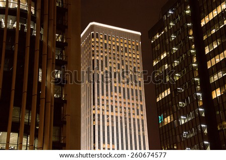Modern office buildings at night in Madrid Spain - stock photo
