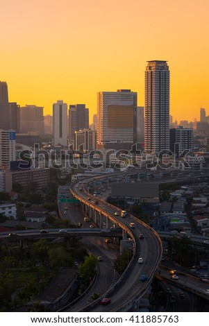 Modern office buildings, condominium in big city downtown with Motorway, Expressway, Freeway the infrastructure for transportation in modern city, urban view at sunset time - stock photo