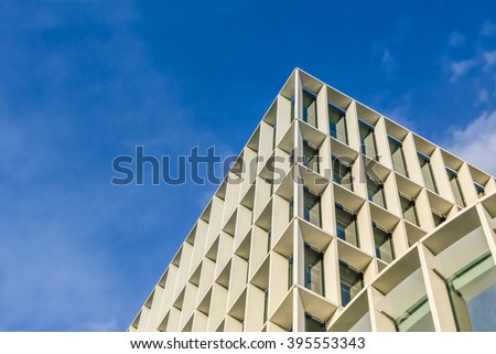 Modern office buildings in central London. Perspective and bottom angle view of modern glass building skyscrapers against blue cloudy sky. Composition of skyscrapers in business district. - stock photo