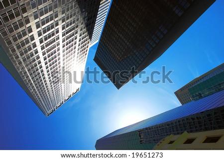 Modern office buildings in New York over blue sky - stock photo