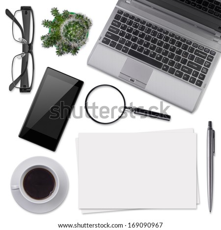 Modern office desk supplies isolated on white - stock photo