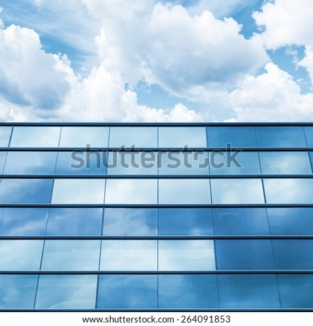 Modern office facade perspective. Blue mirrored glass and cloudy sky - stock photo