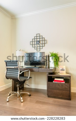 Modern office interior with leather chair and wooden furniture. Interior design. - stock photo