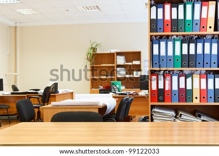 Modern office interior with tables, chairs and bookcases. Nobody - stock photo