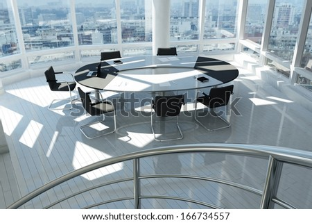Modern office with many windows and city landscape - stock photo