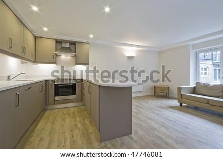 modern open plan kitchen with hard wood floor - stock photo