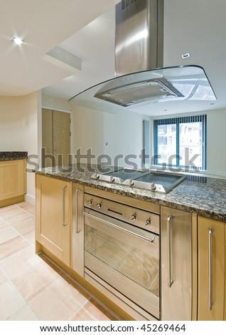 modern open plan kitchen with luxury cooking isle - stock photo