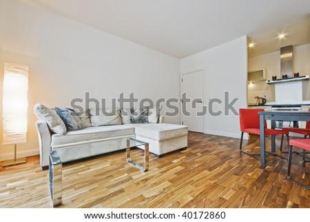 modern open plan living room with bulky corner sofa - stock photo