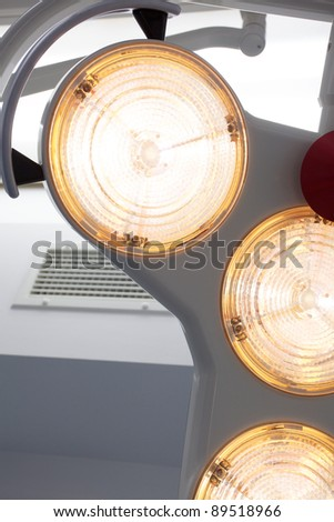 Modern operating theater lights in a new surgical room - stock photo