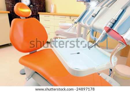 Modern orange dentist chair waiting for clients - stock photo