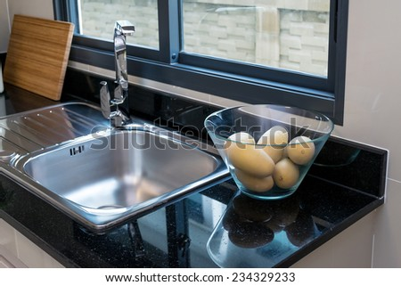 modern pantry with utensil and sink in kitchen - stock photo