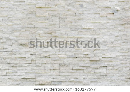 modern pattern of real stone wall decorative surface - stock photo